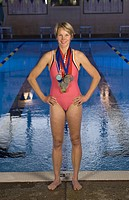 Female swimmer wearing medals