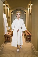 Woman in bathrobe at spa