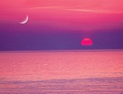 Moon and setting sun over Straits of Juan De Fuca, from San Juan Island, Washington State, USA