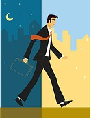 Businessman walking from night into day