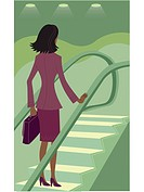 Businesswoman riding an escalator