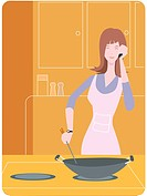 Woman cooking with a wok and talking on the phone