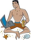 Man using his laptop at the beach