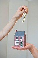 People holding keys and house