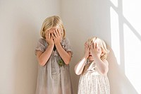 Girls playing hide and seek