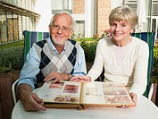 Senior couple looking at a photo album