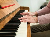 Senior woman playing the piano