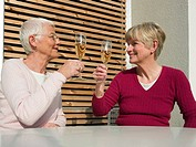 Senior women drinking champagne