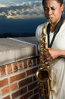 A woman playing the saxophone