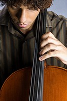 A young man playing the cello