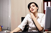 Businesswoman at desk on phone (thumbnail)