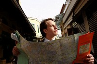 Businessman with a map (thumbnail)
