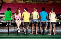 Teenagers at game in amusement park