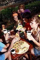 Teenagers hanging out, eating (thumbnail)