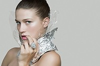 Portrait of a woman wearing recycled foil accessories