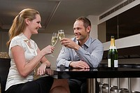 Couple drinking champagne in a bar (thumbnail)
