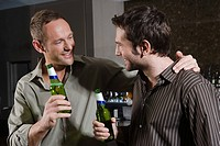 Two men drinking in a bar