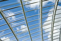 Sky through large greenhouse