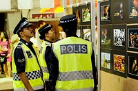 Police looking through the photos displayed by Sarawak Photo-Art society.