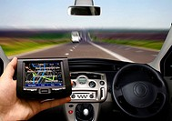 GPS vehicle navigation system in the hand of a man