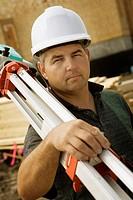 A surveyor at a construction site