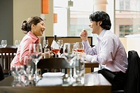 Asian couple at restaurant