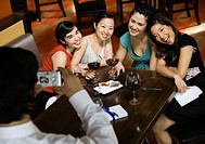 Multi-ethnic female friends having photograph taken