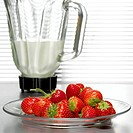 Strawberries in front of mixer, close-up