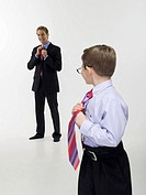 Father and son 8-9 in business clothing, portrait