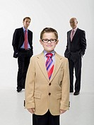 Grandson 8-9 grandfather and son wearing business cloth, portrait