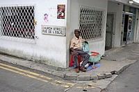 Seychelles, island Mahe, Viktoria, street-corner, man, sale, Devotionalien, no models island state, Church Street, house-corner, people, release, Indi...