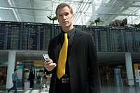 Get along businessman, cell phone, airport, takeoff-hall,