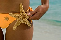 Hispanic woman holding starfish