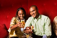 African couple toasting with cocktails