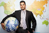 Indian businessman holding globe