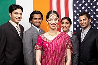 Indian businesspeople in front of flags