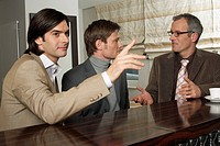 Businessmen Meeting at a Bar