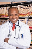 African American male doctor with arms crossed