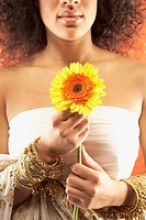 African woman holding flower