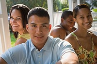 Multi-ethnic friends sitting on porch