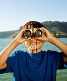 Hispanic boy looking through binoculars