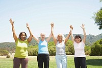 Multi-ethnic senior women cheering