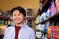 Asian man in pet store