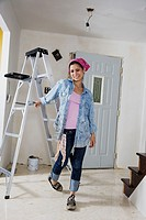Middle Eastern woman next to ladder