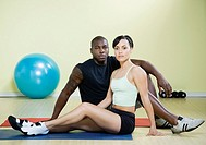 Multi-ethnic couple on yoga mats
