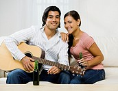 Multi-ethnic couple with guitar