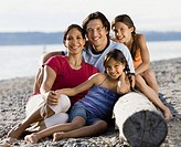 Multi-ethnic family at rocky beach