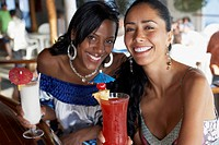 Multi-ethnic women with cocktails