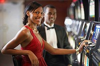 Mixed Race woman at slot machine