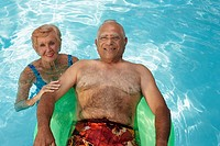 Multi-ethnic senior couple in swimming pool